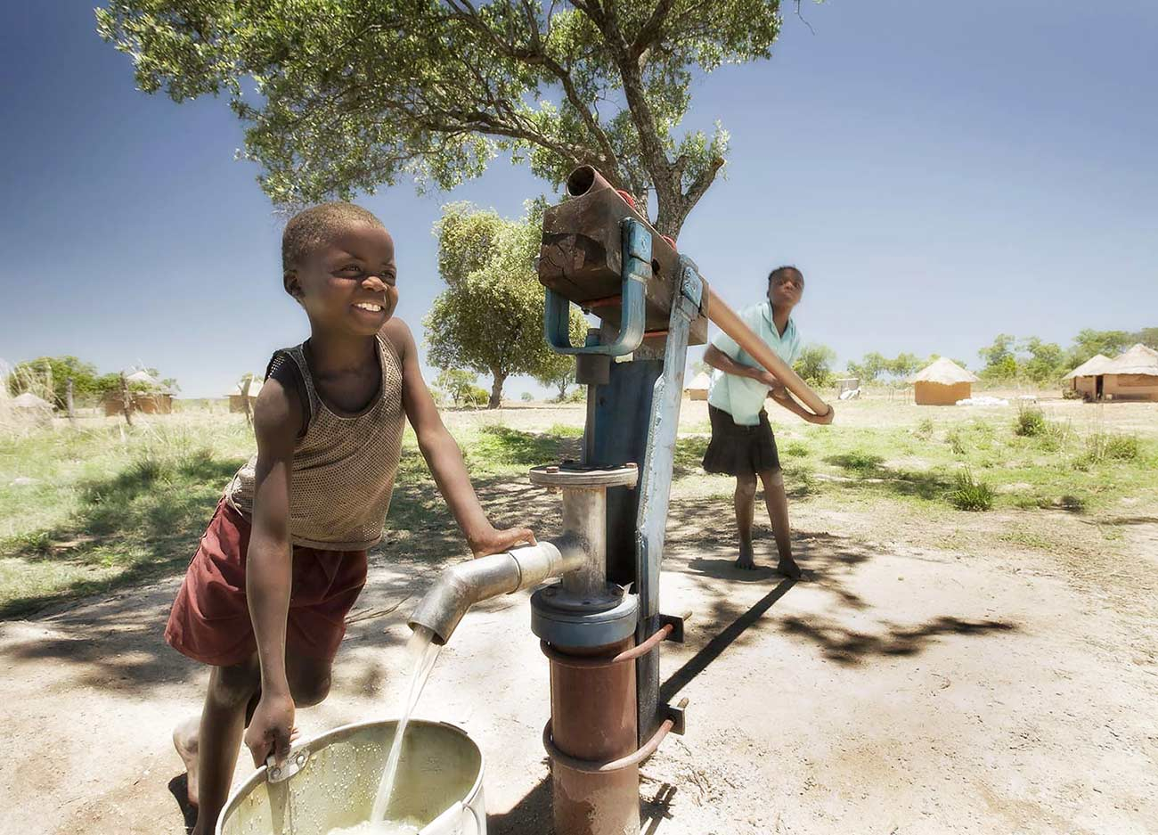 A borehole water supply installed for a village community by a mine in the area - CSI photography portfolio