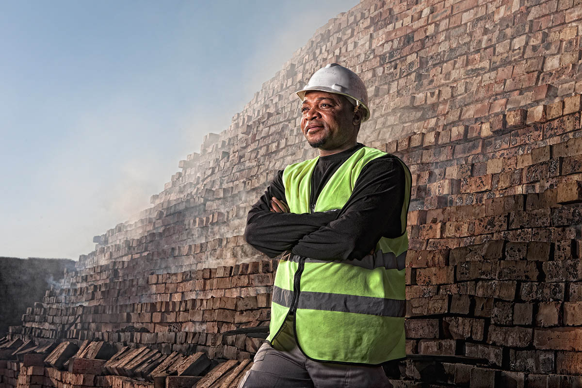 Industrial portrait of a manager at a brickmaking kiln