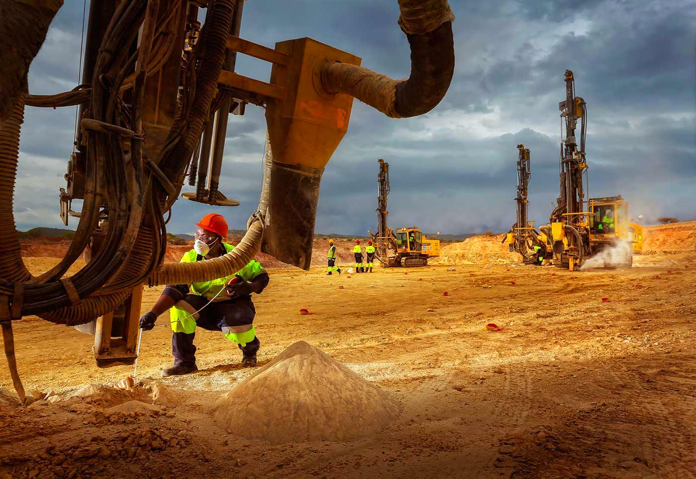 Drill rig operator checks bore depth at diamond mine - people in mining photographs