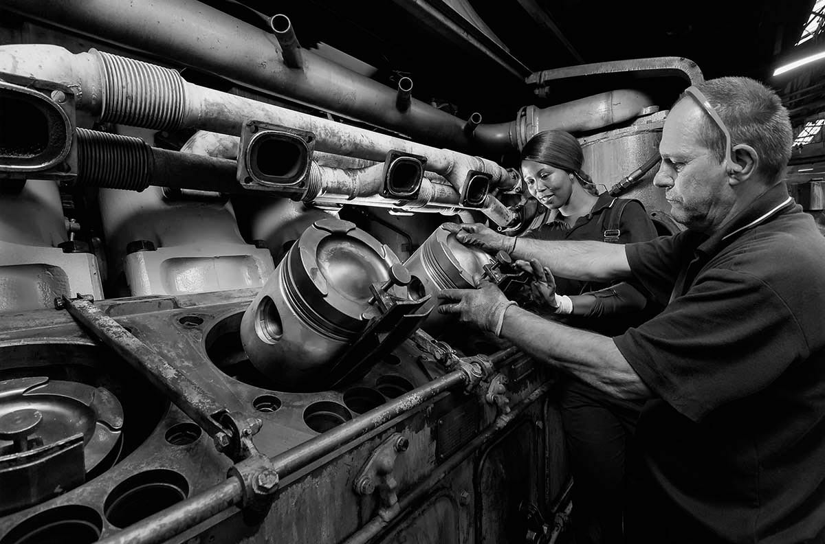 Diesel mechanics working on locomotive engine - professional industrial photography portfolio