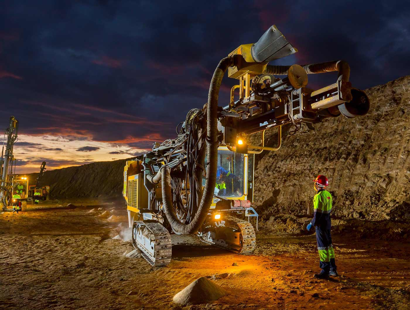 Drill rig on diamond mine at sunset - mining equipment photography portfolio
