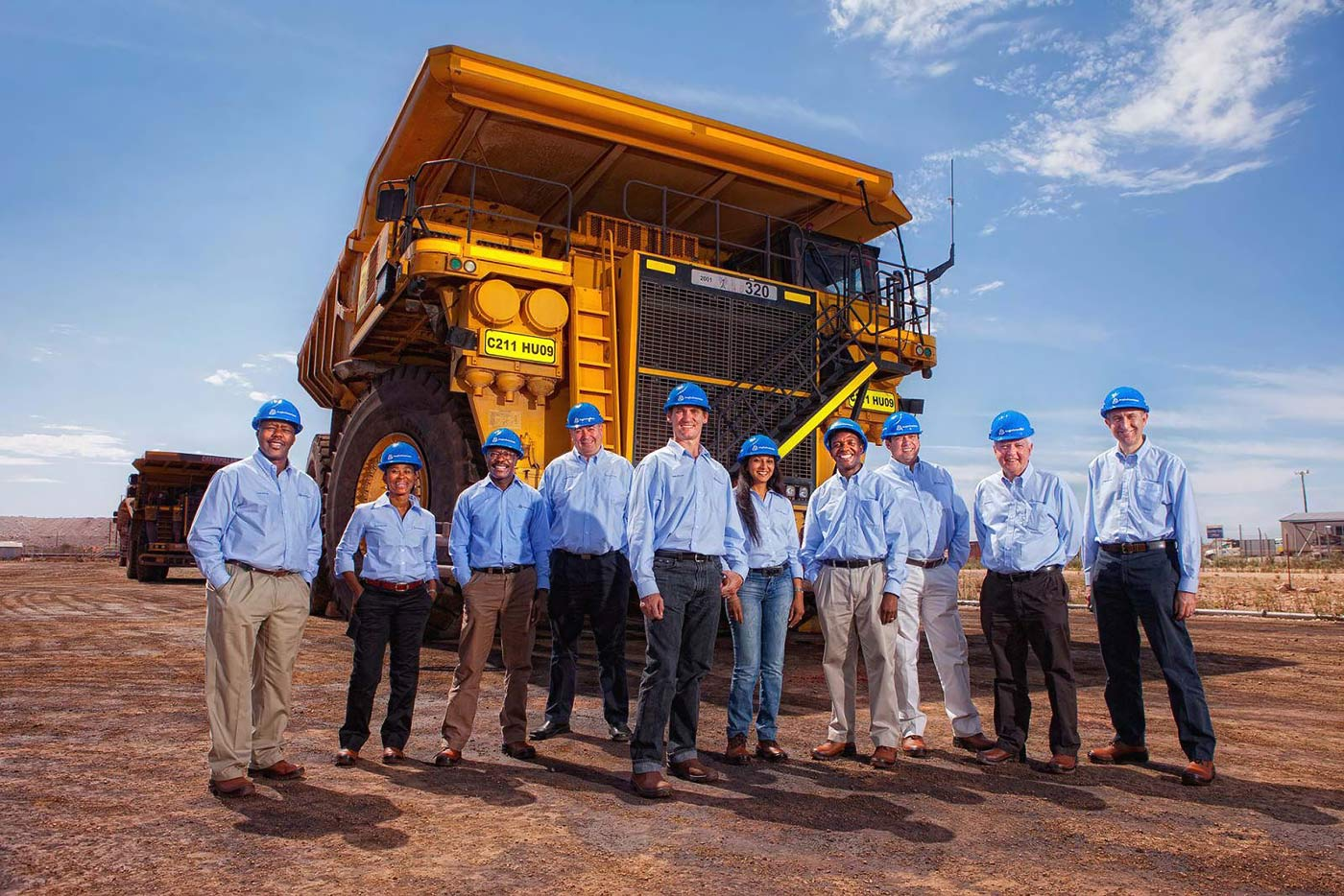 Mining group executives with haul truck - corporate and mining photography portfolio