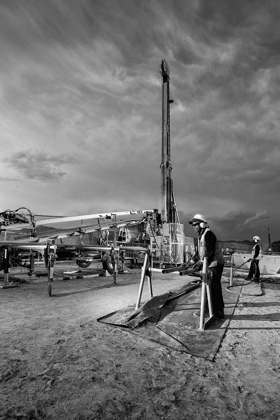 Changing drill rods at an exploration drilling operation - mining photography