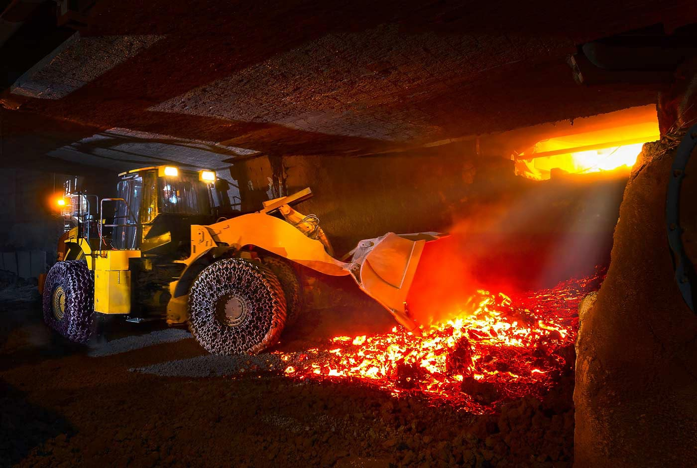 Loader clearing slag from furnace - yellow metal annual report photography portfolio
