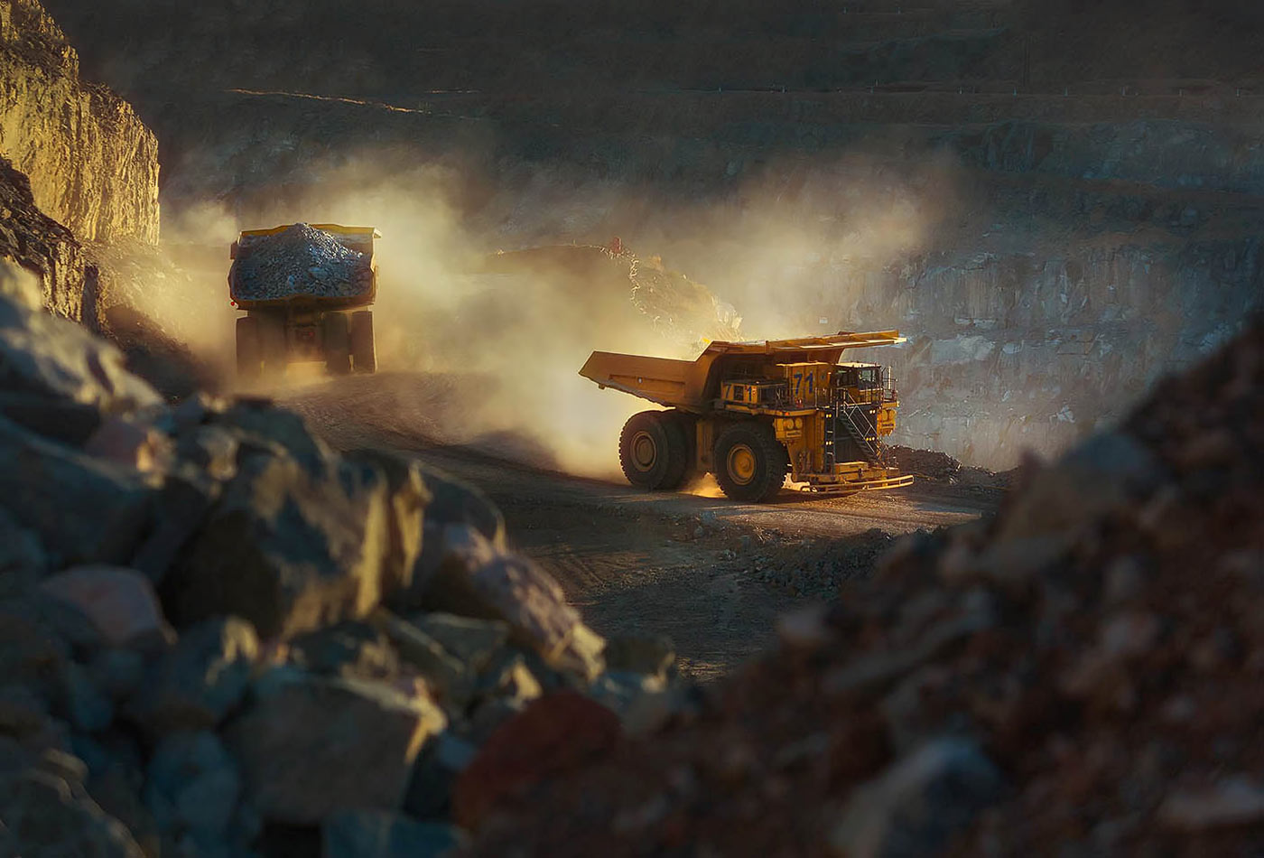 Haul trucks in action at open pit mine - professional mining equipment photography