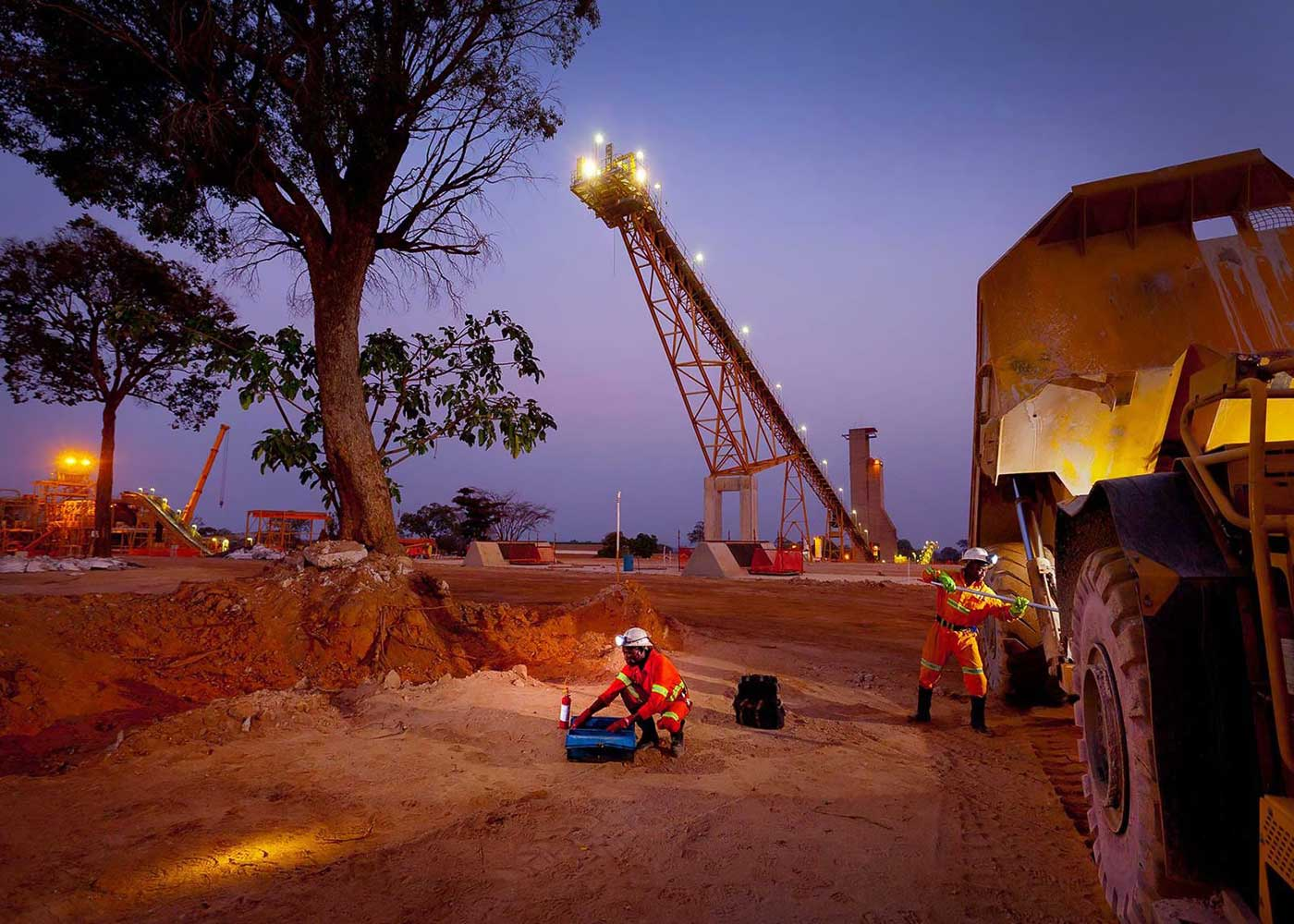Mechanic maintain mining machine at night - people in mining photography collection
