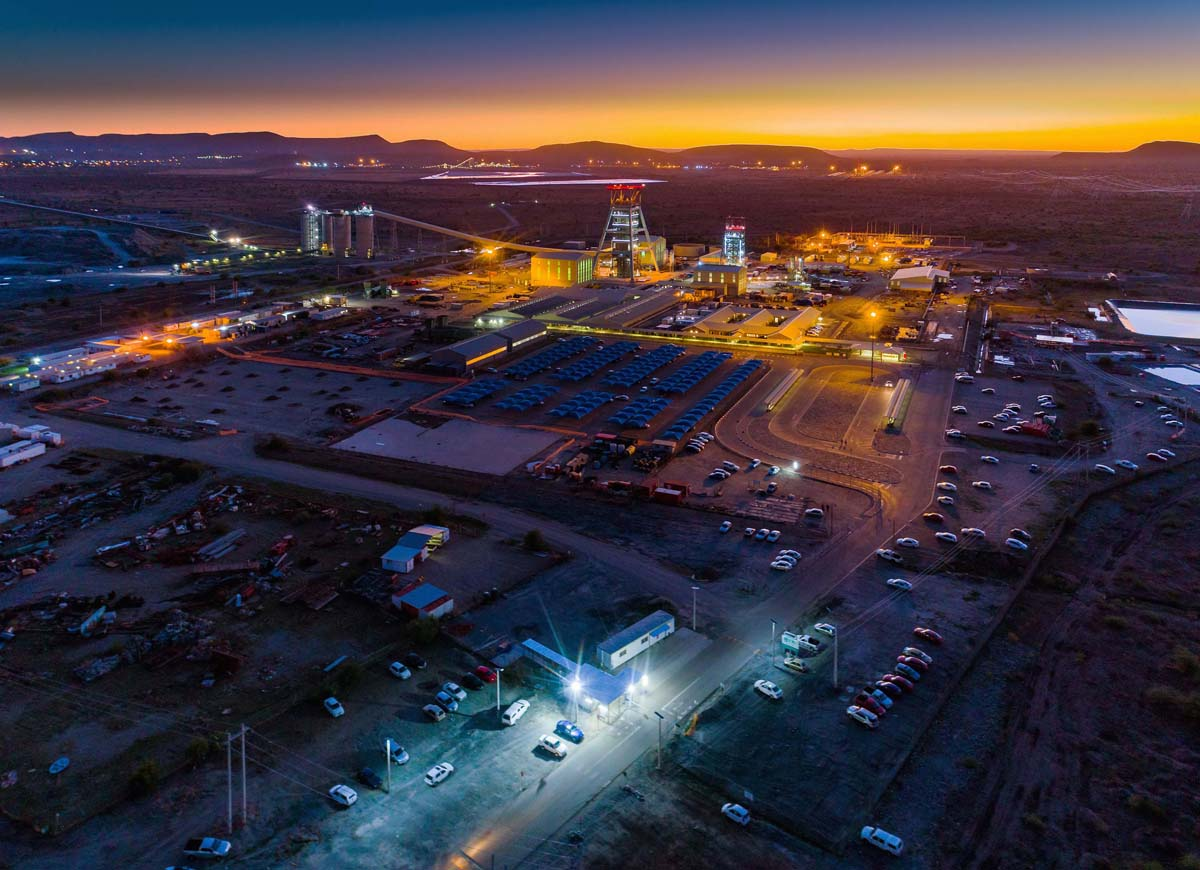 Aerial view of mining operations and infrastructure at night