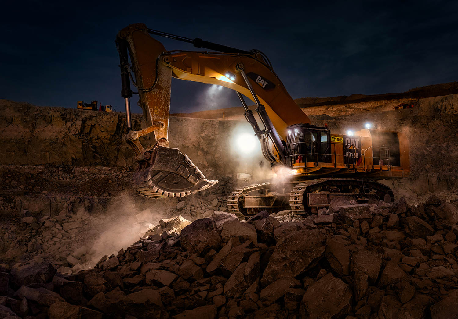 Mining excavator at work at night in an open pit mine