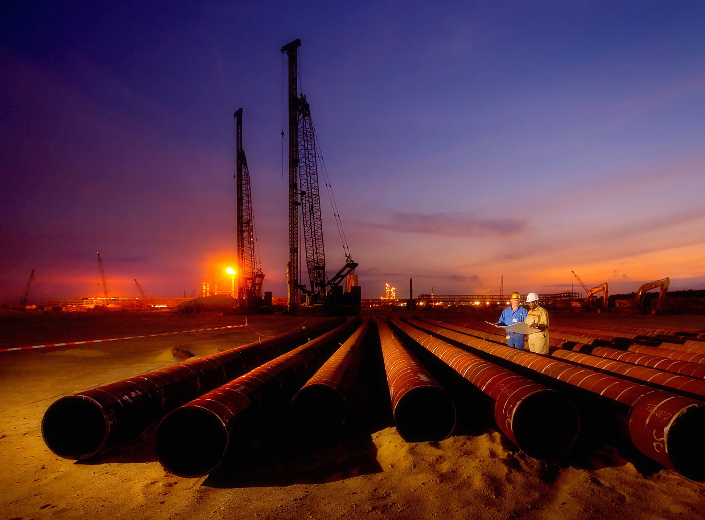 Gas pipeline installation on oil field - petrochemical photography portfolio