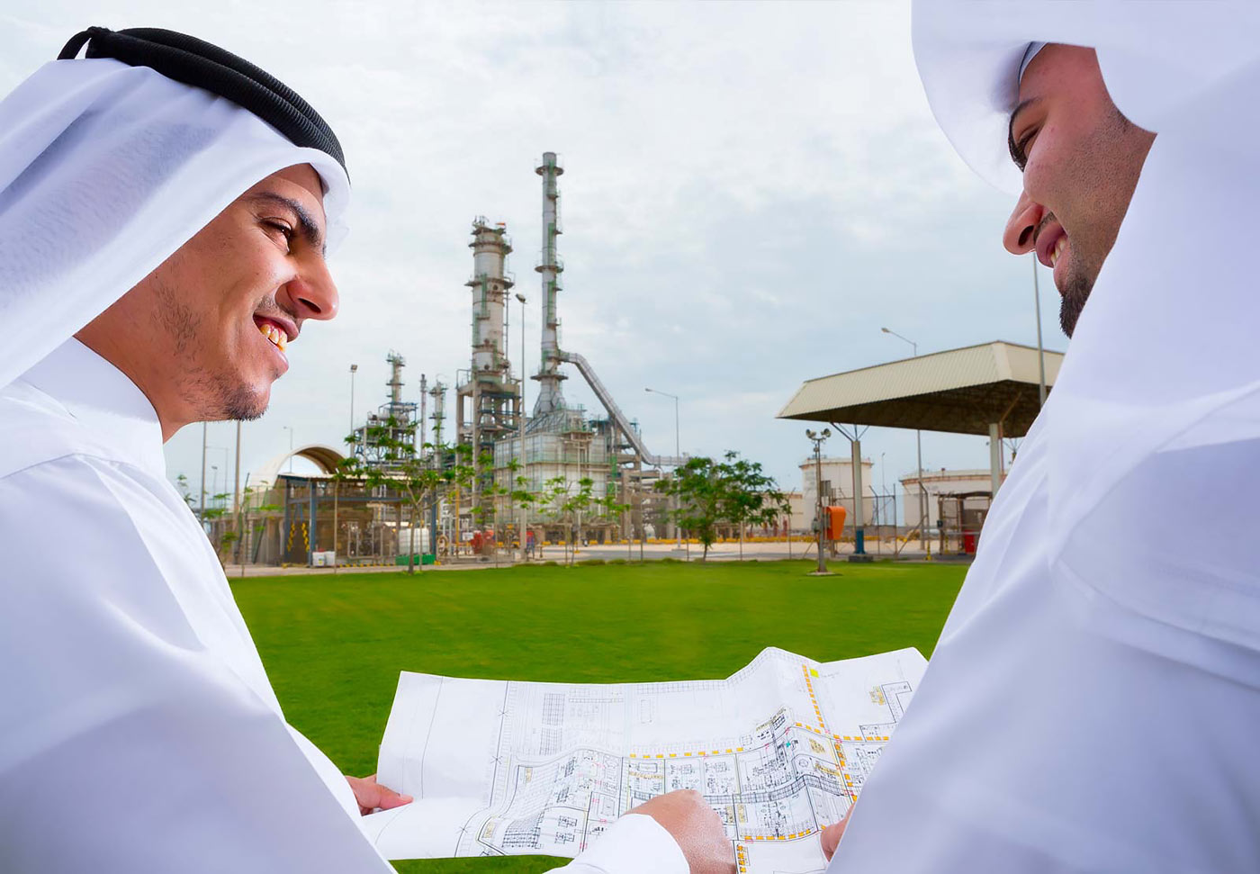 Oil company executives in the Middle East reviewing plant blueprints - corporate photography by Planet KB