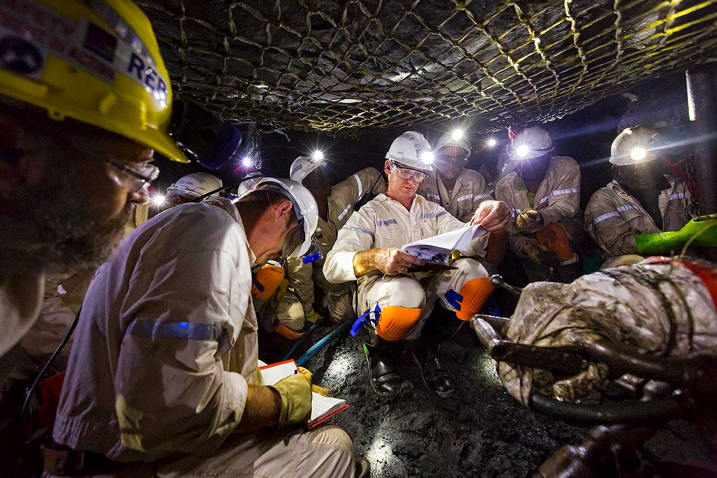 Underground safety discussions in the stopes of a platinum mine - people in mining photography portfolio