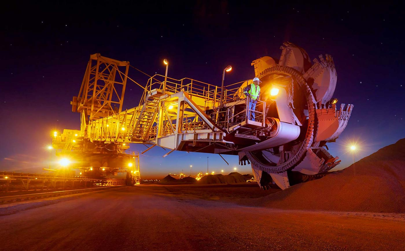 Reclaimer on the stockpiles at iron ore mine - mining equipment photography collection