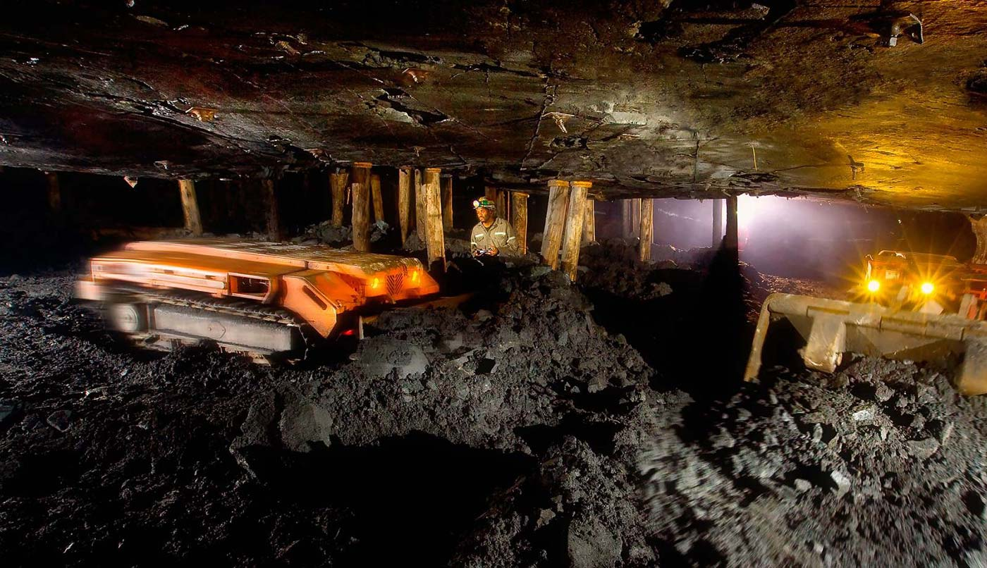 Remote controlled dozer in extra low profile underground mining section - underground photography