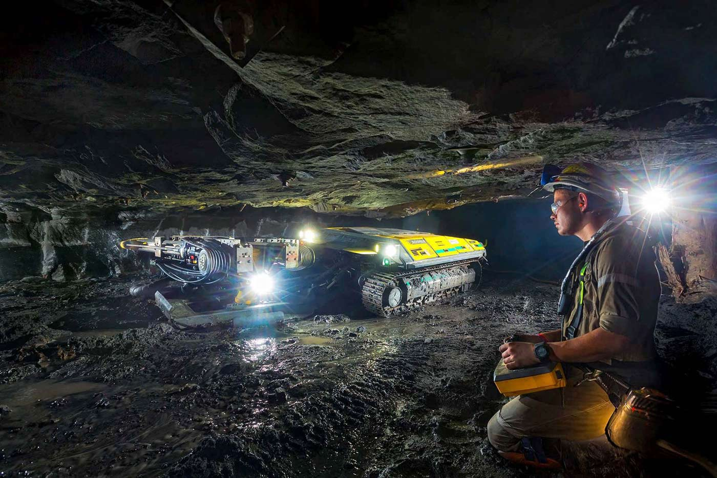 Remote controlled drill rig in Ultra Low Profile stopes of underground mine - mining equipment photography portfolio