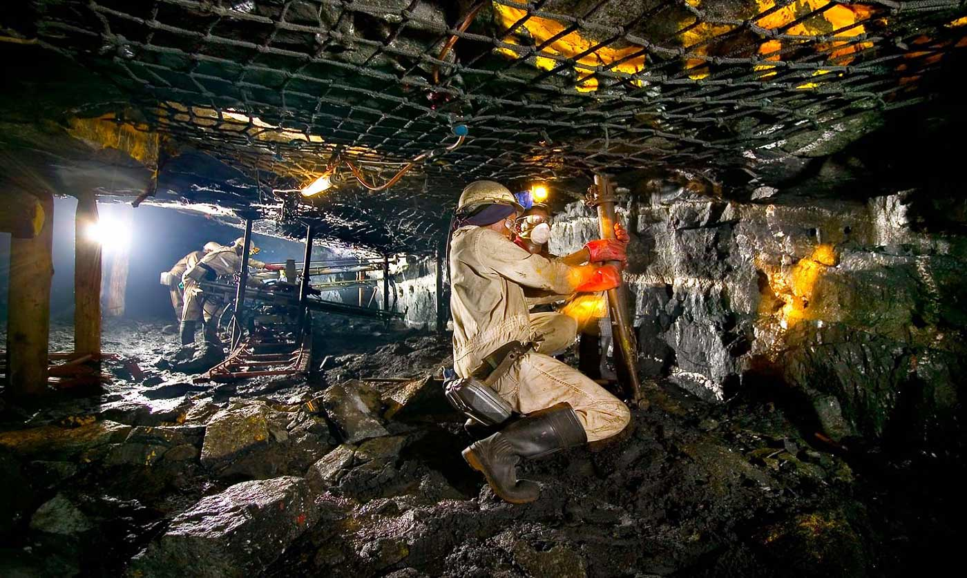 Rock drill operators in conventional mining stopes - Mine safety photography