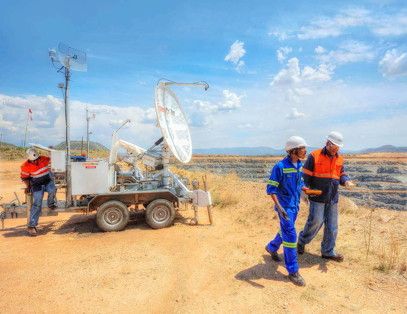 Technicians inspect a slope stability radar system - mining photography portfolio