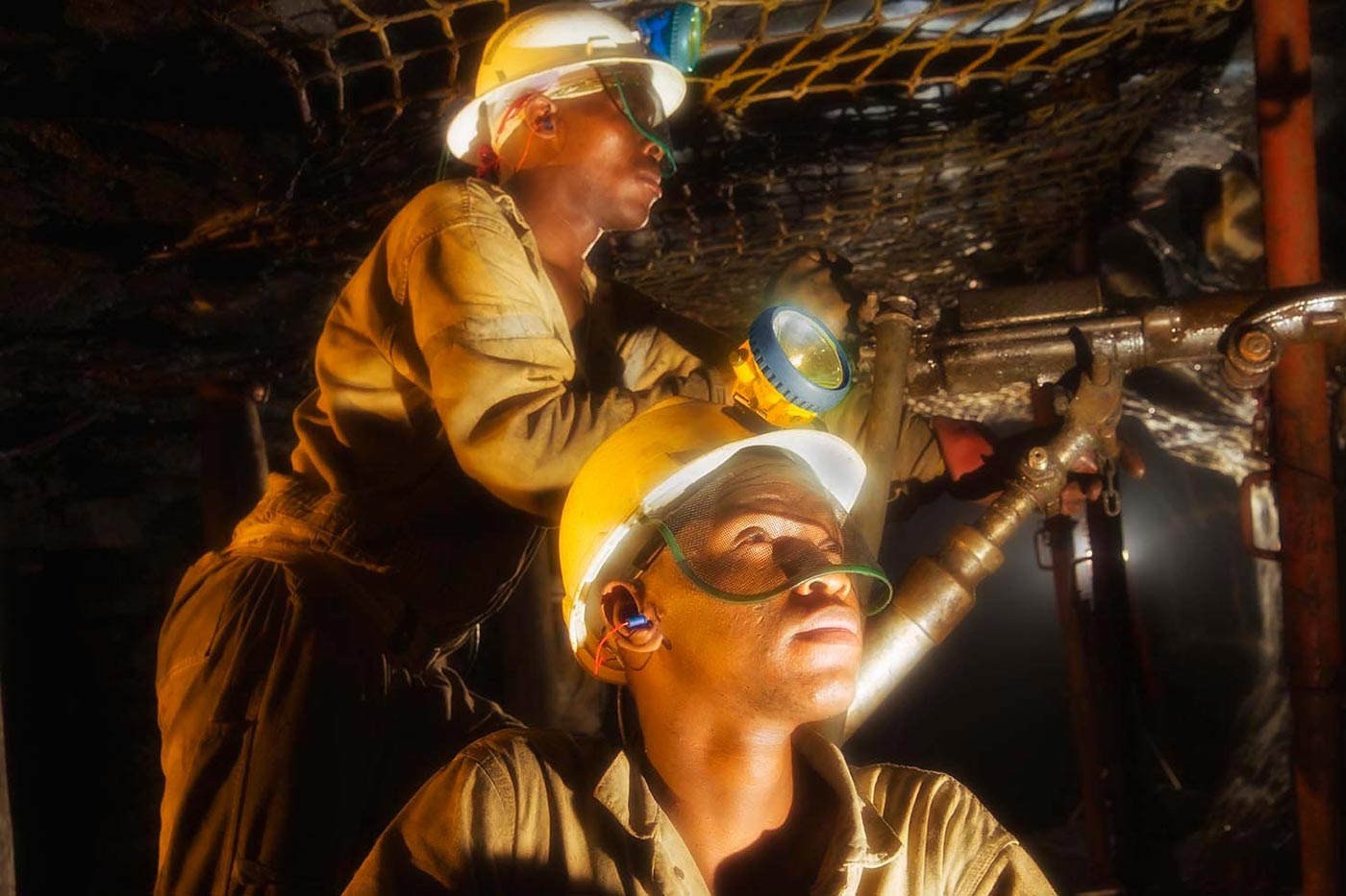 Underground rock drill operators in platinum mine - underground mining photography collection