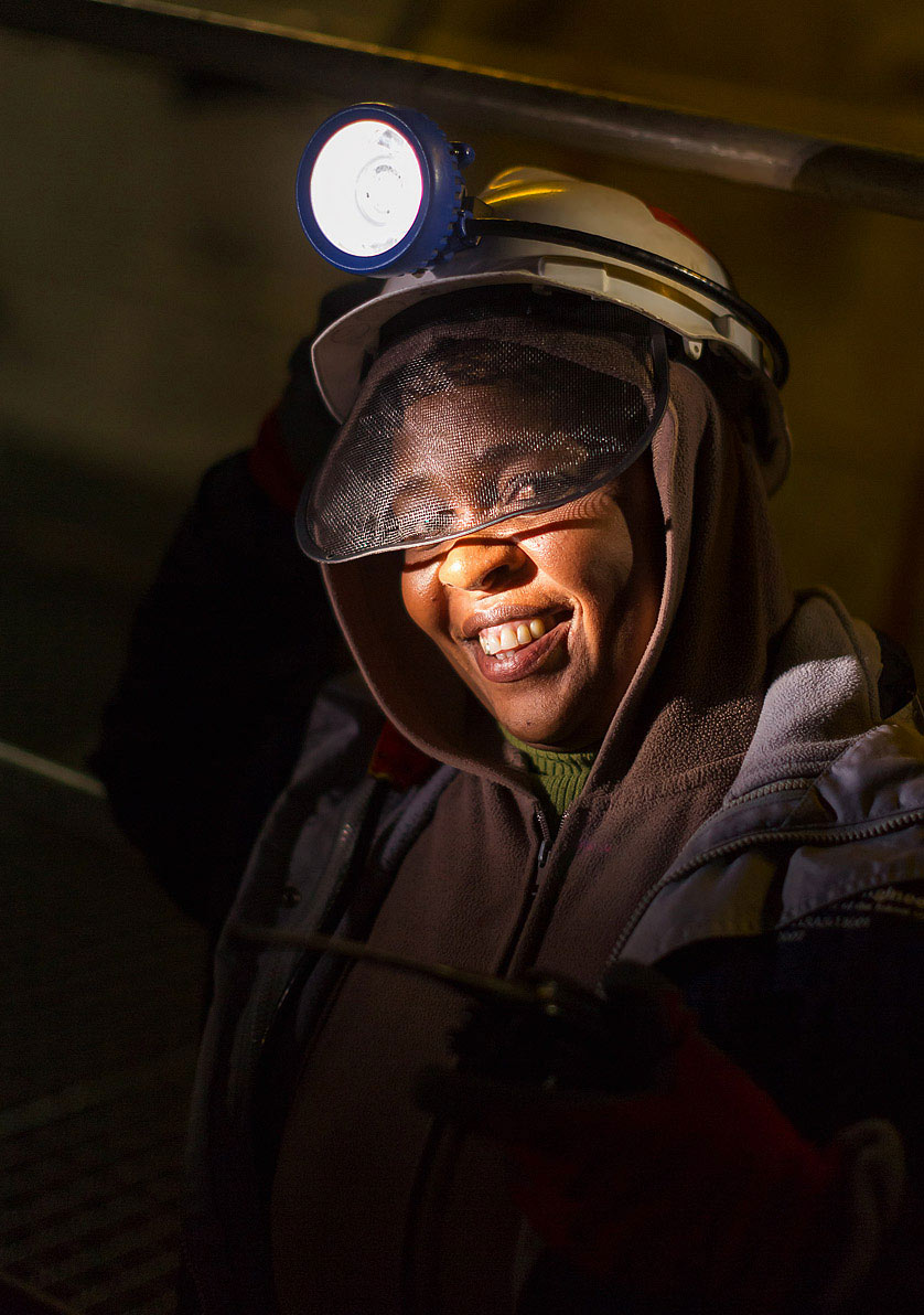 Female underground miner on platinum mine - mining photography by Planet KB